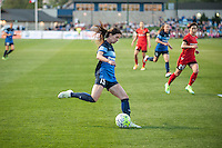 Kansas City, Mo. - Saturday April 23, 2016: FC Kansas City midfielder Erika Tymrak (15) crosses the ball during a match against Portland Thorns FC at Swope Soccer Village. The match ended in a 1-1 draw.