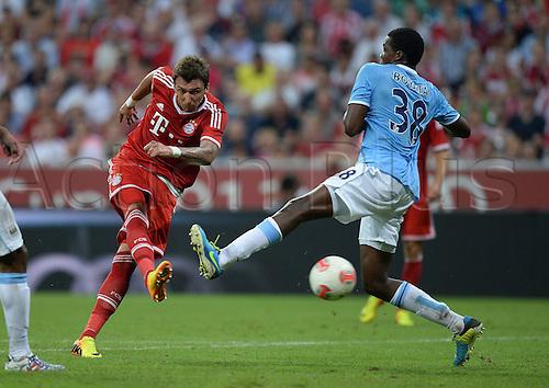 01.08.2013. Munich, Germany. Audi Cup 2013  Final FC Bayern Munich versus Manchester City  Mario Mandzukic FC Bayern Munich against Dedryck Boyata Rem Manchester City