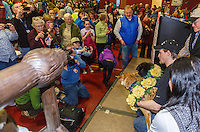 A crowd of race fans take photos of Dallas Seavey and his lead dogs Beatle and Reef as they pose at the musher 's finishers banquet in Nome on Sunday March 16 after the 2014 Iditarod Sled Dog Race.<br /> <br /> PHOTO (c) BY JEFF SCHULTZ/IditarodPhotos.com -- REPRODUCTION PROHIBITED WITHOUT PERMISSION