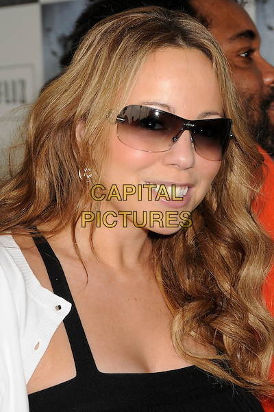 MARIAH CAREY.2009 Film Independent's Spirit Awards - Arrivals in Santa Monica, CA, USA,.21st February 2009..Independent Indie portrait headshot shades black sunglasses white cardigan wavy hair down smiling teeth  .CAP/ADM/BP.©Byron Purvis/Admedia/Capital PIctures