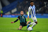 Elias Kachunga of Huddersfield Town is tackled by Matt Grimes of Swansea City during the Sky Bet Championship match between Huddersfield Town and Swansea City at The John Smith's Stadium in Huddersfield, England, UK. Tuesday 26 November 2019