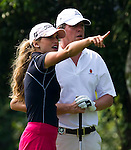HAIKOU, CHINA - OCTOBER 30:  Spanish golfer Belen Mozo (L) gives instructions to Hugh Grant of Great Britain on the 10th tee during day four of the Mission Hills Start Trophy tournament at Mission Hills Resort on October 30, 2010 in Haikou, China. The Mission Hills Star Trophy is Asia's leading leisure liflestyle event and features Hollywood celebrities and international golf stars.  Photo by Victor Fraile / The Power of Sport Images