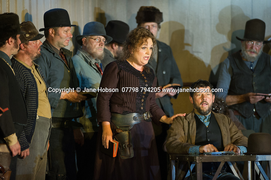 "London, UK. 30.09.2014. English National Opera's production of ""The Girl of the Golden West"", by Giacomo Puccini, directed by Richard Jones, conducted by Keri-Lynn Wilson, opens at London Coliseum. Picture shows: Susan Bullock (Minnie) . Photograph © Jane Hobson."