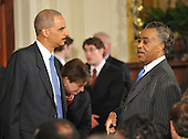 Washington, D.C. - May 26, 2009 -- Reverend Al Sharpton, right, shares some thoughts with United States Attorney General Eric Holder, left, as they await U.S. President Barack Obama's announcement naming Judge Sonia Sotomayor of the Federal Appeals Court as his nominee for Justice of the U.S. Supreme Court in the East Room of the White House on Tuesday, May 26, 2009.  She will replace retiring Justice David Souter. Judge Sotomayor, 54, of The Bronx, New York, will be the first Hispanic to serve if her nomination is approved by the U.S. Senate.  .Credit: Ron Sachs / Pool via CNP