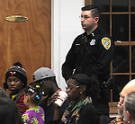 Police Officer M. Defrange, one of the Officers in the audience at a Community Policing Forum, sponsored by the Kingston Branch of ENJAN and the Ministers Alliance of Ulster Co., held at New Progressive Baptist Church, on Hone Street in Kingston, NY, on Tuesday, December 13, 2016. Photo by Jim Peppler; Copyright Jim Peppler 2016.