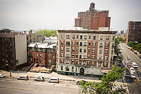 Buildings along St. Nicholas Avenue in Harlem in the Sugar Hill neighborhood in New York is seen on Sunday, July 13, 2014. The St. Nicholas Hotel, an SRO, is on the right next to the converted townhouses. (© Richard B. Levine)