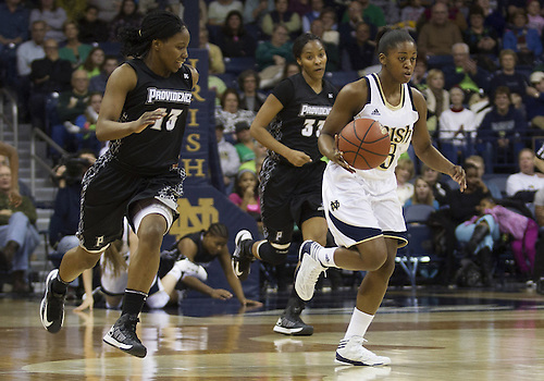 January 26, 2013:  Notre Dame guard Whitney Holloway (3) dribbles the ball as Providence guard Tori Rule (13) defends during NCAA Basketball game action between the Notre Dame Fighting Irish and the Providence Friars at Purcell Pavilion at the Joyce Center in South Bend, Indiana.  Notre Dame defeated Providence 89-44.