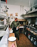 GREECE, Patmos, Skala, Dodecanese Island, chef Benetos in the kitchen of his restaurant, Benetos Restaurant