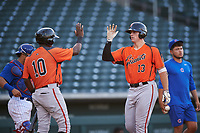 AZL Giants Orange Connor Cannon (13) is congratulated by Marco Luciano (10) after hitting a home run during an Arizona League game against the AZL Cubs 1 on July 10, 2019 at Sloan Park in Mesa, Arizona. The AZL Giants Orange defeated the AZL Cubs 1 13-8. (Zachary Lucy/Four Seam Images)