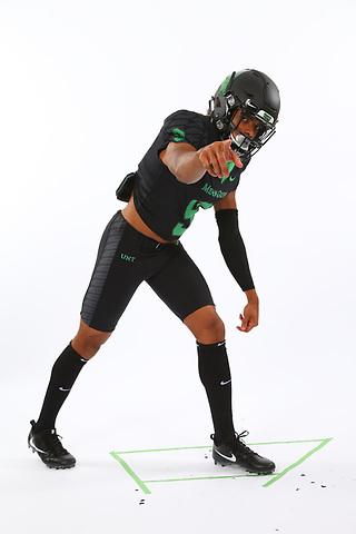 DENTON TEXAS: University of North Texas Mean Green football posed action photos.