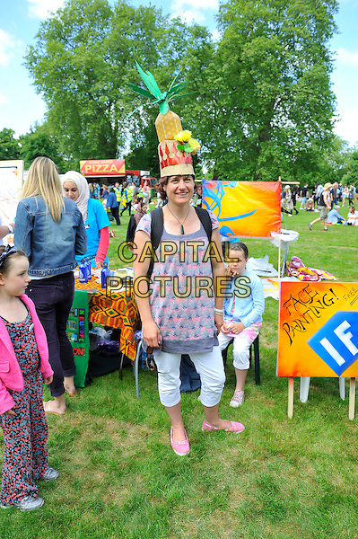 Fan<br /> attending The Big IF, Hyde Park, London, England. <br /> 8th June 2013<br /> full length pink blue pattern top blue trousers cropped costume gv general view concert goer <br /> CAP/MAR<br /> &copy; Martin Harris/Capital Pictures