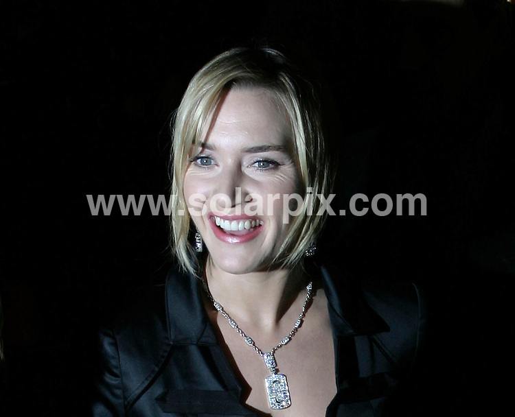 ALL ROUND PICTURES FROM SOLARPIX.COM.SYNDICATION RIGHTS FOR UK, SOUTH AFRICA, DUBAI, AUSTRALIA..Kate Winslet at The Holiday New York Premiere - Arrivals - Ziegfeld Theater - New York, NY..DATE: 29/11/2006-JOB REF: 3145-PHZ.**MUST CREDIT SOLARPIX.COM OR DOUBLE FEE WILL BE CHARGED**