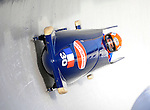 15 December 2007: France 1 pilot Michael Serise with brakeman Alexandre Jolivet exit a turn during their first run at the FIBT World Cup Bobsled Competition at the Olympic Sports Complex on Mount Van Hoevenberg, at Lake Placid, New York, USA. ..Mandatory Photo Credit: Ed Wolfstein Photo