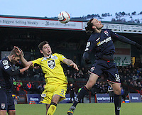 The ball evades Jackson Irvine (right) and Kenny McLean (centre) in the Ross County v St Mirren Scottish Professional Football League match played at the Global Energy Stadium, Dingwall on 17.1.15.
