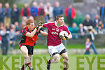 Dromid Niall O'Shea and Glenbeigh/Glencar Pa Kilkenny in action during their Junior championship semi final clash in Killorglin on Sunday