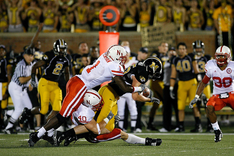 Nebraska Cornhuskers cornerback Zack Bowman (1) and linebacker Lance Brandenburgh (40) tackle MU tight end Chase Coffman (45) on a 17 yard pass play during the first quarter at Memorial Stadium in Columbia, Missouri on October 6, 2007. The Tigers won 41-6.