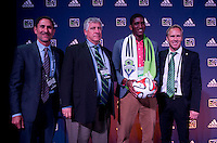 #8 overall pick Damian Lowe of the Seattle Sounders stands with head coach Sigi Schmid (2nd to left) and owner Adrian Hanauer during the MLS SuperDraft at the Pennsylvania Convention Center in Philadelphia, PA, on January 16, 2014.