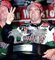NASCAR driver Bobby Labonte celebrates his third win of the season after the rain-shortened Pepsi Southern 500 in Darlington, SC on Sunday, 9/3/00.(Photo by Brian Cleary)  (Photo by Brian Cleary/www.bcpix.com)