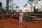 Amanda Porter and her aughter Krista Holbrooks, 5, stand just outside of their home that is being rebuilt in Vaughn, a small community in Georgia that was devastated by a tornado in April.