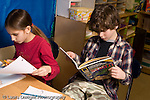Elementary school Grade 5 social studies boy and girl working separately horizontal