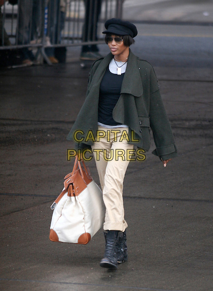 NAOMI CAMPBELL.Arriving to the Sanitation Department of New York on her fifth day of Community Service, New York, NY, USA. .March 23rd, 2007.full length beige trousers grey gray jacket sunglasses shades big large bag white black boots.CAP/IW.©Ian Wilson/Capital Pictures