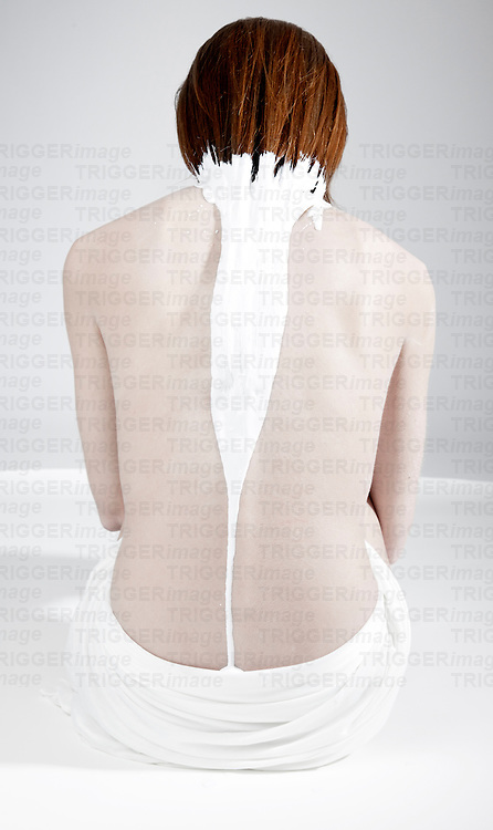 woman with paint dripping on het back