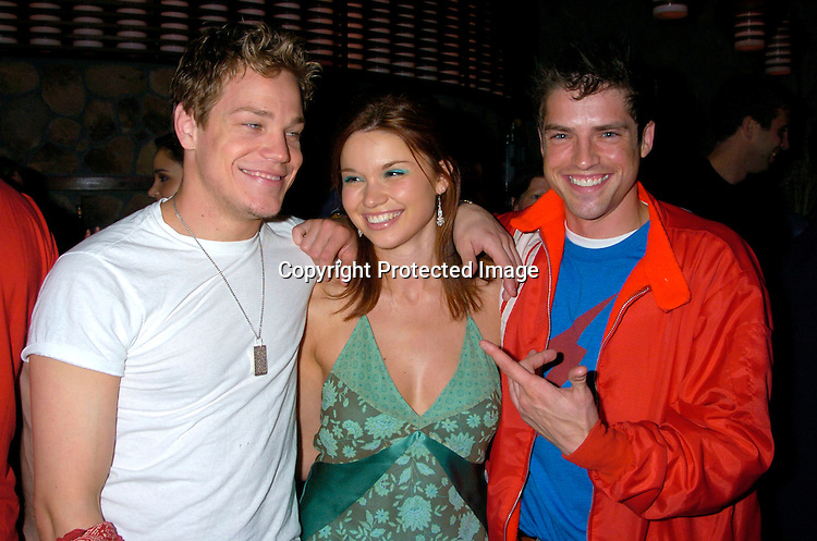 Marty West, Mandy Bruno and Scott Bailey ..at Marcia Tovsky's Pre Emmy party at Quo on May 19, 2004. ..Photo by Robin Platzer, Twin Images