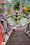 Steep steps descend to the courtyard and fountain near the entrance of the Bramavihara-Arama Buddhist Temple in northern Bali, Indonesia.