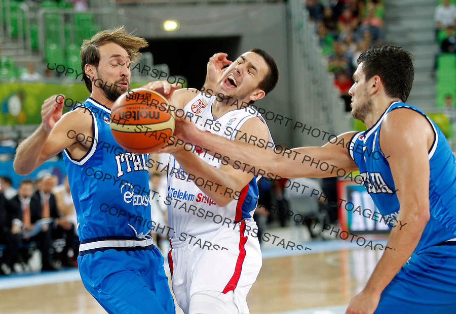 "Vasilije Micic of Serbia (C)  in action during European basketball championship ""Eurobasket 2013""  basketball game for 7th place between Serbia and Italy in Stozice Arena in Ljubljana, Slovenia, on September 21. 2013. (credit: Pedja Milosavljevic  / thepedja@gmail.com / +381641260959)"