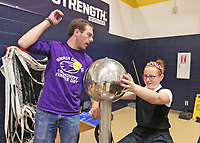 Guerin Catholic students set up a science expo for the students at Our Lady of Mt. Carmel. The students were able to move from demonstration to demonstration and see science in action.  JP Spoonmore shows what static electricity does to 5th grader Aydah Leising.