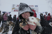 Junior Iditarod champion Conway Seavey (a 3rd generation Seavey dog musher) poses with his lead dogs Memphis (left) and Sarge at the finish line after winning the 2012 Junior Iditarod.