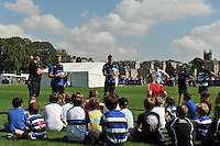 Chris Cook and Luke Arscott of Bath Rugby runs the kicking clinic. Bath Rugby Family Festival of Rugby, on August 8, 2015 at the Recreation Ground in Bath, England. Photo by: Patrick Khachfe / Onside Images