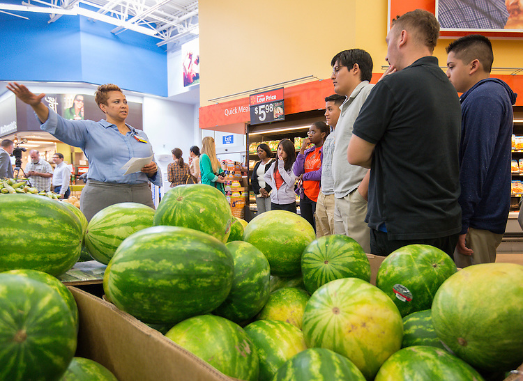 Scarborough High School students listen as Walmart store manager Tannika Scott talks about seasonal retail strategies, May 22, 2014.