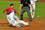 23 July 2011: Los Angeles Dodgers outfielder Eugenio Velez slides home safely on a wild pitch by Henry Rodriguez, scoring the game-tying run in the bottom of the 7th against the Washington Nationals at Dodger Stadium in Los Angeles, California. The Dodgers rallied to defeat the Nationals 7-6 on a Rafael Furcal walk-off, RBI double in the bottom of the 9th inning. Mandatory Credit: Ed Wolfstein Photo