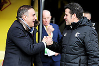 (L-R) Swansea manager Carlos Carvalhal greets Watford manager Marco Silva during the Premier League match between Watford and Swansea City at the Vicarage Road, Watford, England, UK. Saturday 30 December 2017