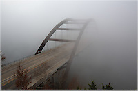 The iconic Austin Bridge (Pennybacker Bridge) fades into a thick fog on a cold December morning.