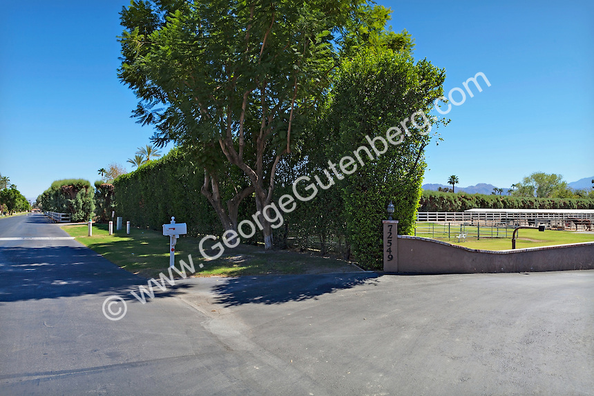 Entry gate to equestrian ranch property
