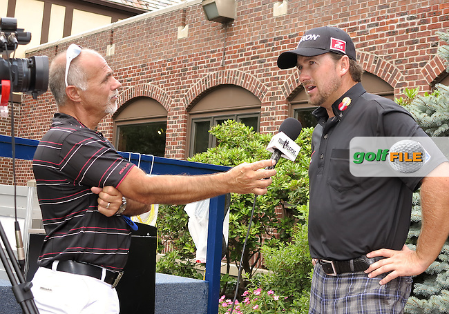 07 AUG 13 Vidio Journalist Tom Auclair of Tour Players.com with Ulsterman Graeme McDowell during Wednesdays Practice at The 95th PGA Championship at The Oakhill Country Club in Rochester, New York.  (photo:  kenneth e.dennis / kendennisphoto.com)