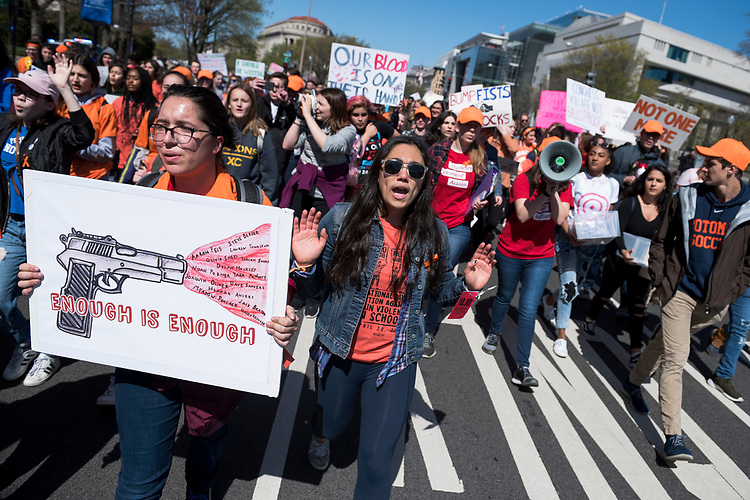 UNITED STATES - APRIL 20: Students march to the Capitol on Pennsylvania Avenue to call on Congress to act on gun violence prevention during a national walkout on April 20, 2018, which marks the 19th anniversary of the Columbine High School shooting in Colorado. (Photo By Tom Williams/CQ Roll Call)