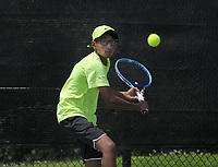 NWA Democrat-Gazette/BEN GOFF @NWABENGOFF<br /> Vikram Balasekaran of Bentonville competes Sunday, July 16, 2017, in the boys 16 singles consolation match during the Serena Smith State Farm Junior Open State tennis tournament at the Memorial Park tennis courts in Bentonville.