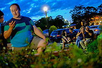 EAGLE ROCK, NJ - JUNE 09: People take a look their pictures as the Strawberry Moon rises over lower Manhattan on June 06, 2017 in Montclair, New Jersey. Photo by VIEWpress/Eduardo MunozAlvarez