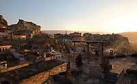 View over the town of Urgup at sunrise, on Temenni Tepesi or Wish Hill, in Nevsehir province, Cappadocia, Central Anatolia, Turkey. Urgup was one of the first areas to be settled in the region and is now a tourist centre and home to the Cappadocian wine trade. Many of the houses here are built in or above caves cut into the soft volcanic rock. This area forms part of the Goreme National Park and the Rock Sites of Cappadocia UNESCO World Heritage Site. Picture by Manuel Cohen