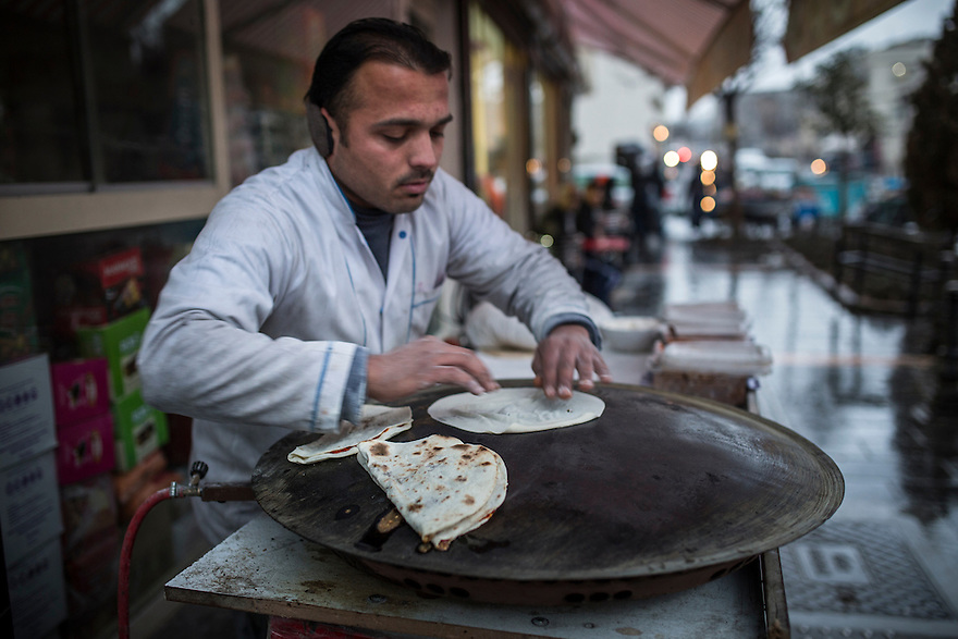 "At the Original Halep Lokanta, flatbread stuffed with za'tar (thyme) and other Syrian style fillings is cooked outside in the ""Little Aleppo"" neighborhood of Gaziantep."