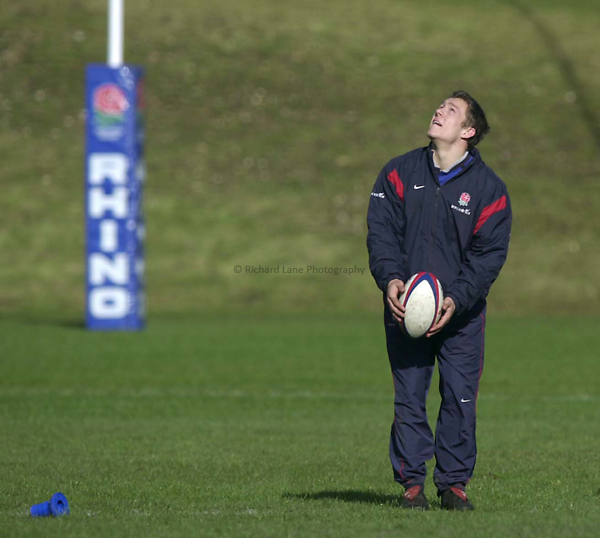 Photo. Richard Lane. .England Squad Training at Pennyhill Hotel, Bagshot.. 27-2-2002.Jonny Wilkinson looks to the heavens.