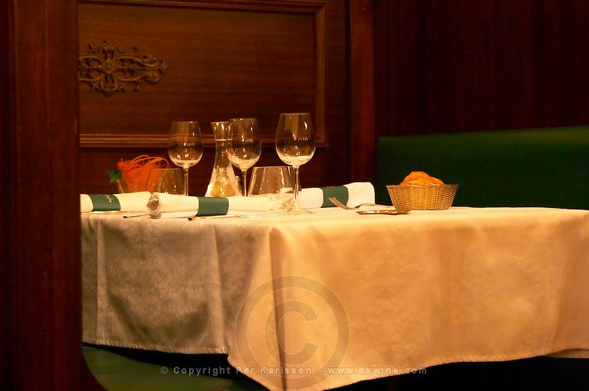 The restaurant Le Chaudron in Tournon: a table set with linen table cloth and wine glasses, napkins knives forks Tournon-sur-Rhone, Ardeche Ardèche, France, Europe