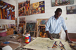 """Tom Mboya, worked in hotels for 9 years before quitting to follow his dream of being a painter. Times are hard he says, """"no one of us can say we are in this to make good money."""""""