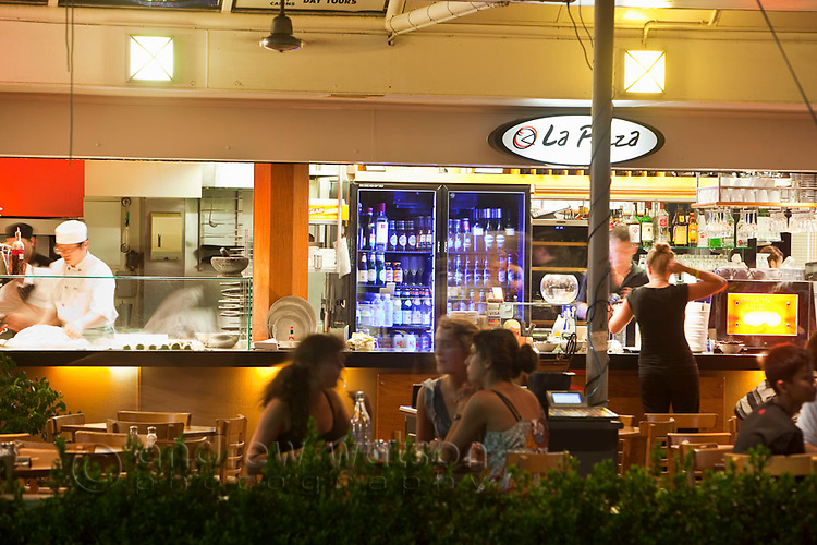 Diners at La Pizza on the Esplanade at night.  Cairns, Queensland, Australia