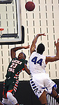 Lincoln Trail College player Dennis Hightower (23, left) has the ball slapped away by Southwestern College player Ekene Anachebe (44) as he was shooting in the first half.