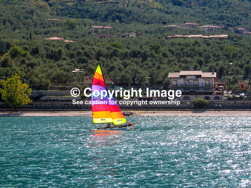 Yacht sailing on Lake Garda, Italy, 200609180092..Copyright Image from Victor Patterson, 54 Dorchester Park, Belfast, UK, BT9 6RJ..Tel: +44 28 9066 1296.Mob: +44 7802 353836.Voicemail +44 20 8816 7153.Skype: victorpattersonbelfast.Email: victorpatterson@mac.com.Email: victorpatterson@ireland.com (back-up)..IMPORTANT: If you wish to use this image or any other of my images please go to www.victorpatterson.com and click on the Terms & Conditions. Then contact me by email or phone with the reference number(s) of the image(s) concerned.