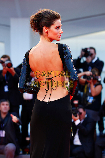 Marica Pellegrinelli.The 'Lines Of Wellington' (Linhas de Wellington) Premiere during The 69th Venice Film Festival at the Palazzo del Cinema, Venice, Italy. .September 4th, 2012 .half length black dress backless tied profile back behind rear looking over shoulder sequins sequined .CAP/IPP/GR.©Gianluca Rona/IPP/Capital Pictures.